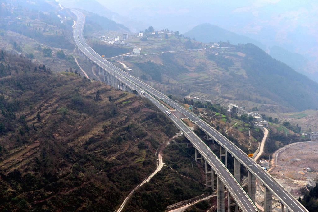 Photo taken on Dec. 27, 2014 shows a segment of the Shanghai-Chengdu Expressway in Badong County of Enshi, central China's Hubei Province. The 1,966-kilometer ...