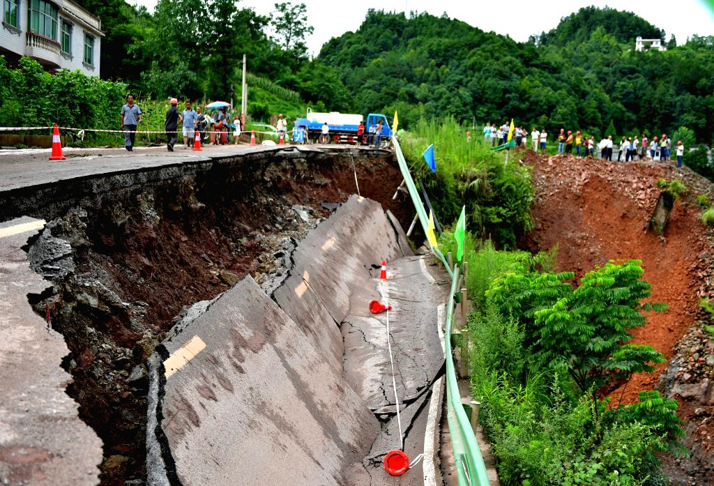 ENSHI, July 15, 2016 - Photo taken on July 15, 2016 shows the landslide site in Xuan'en County of Enshi, central China's Hubei Province. A rain-triggered landslide occurred on a section of No. 209 ...