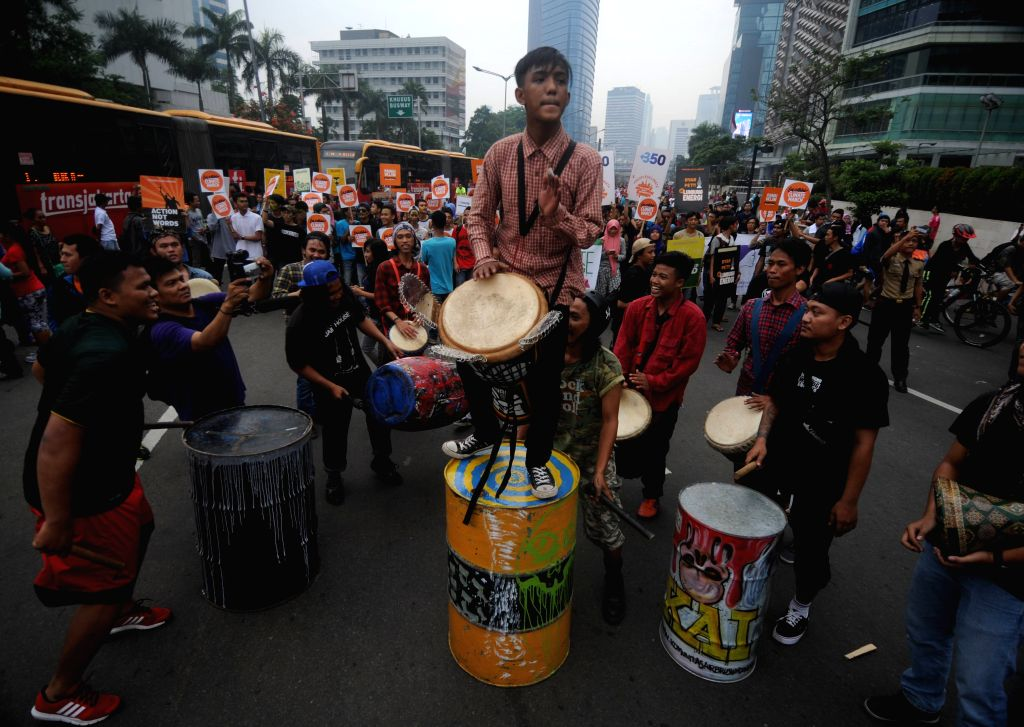 Environment activists attend a rally ahead of the 21st United Nations climate change conference (COP21) in Jakarta, Indonesia, Nov. 28, 2015. Hundreds of ...
