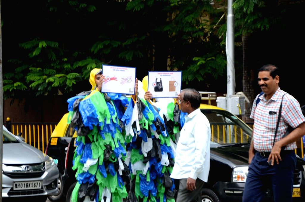 Environment activists where Polyethylene bags all over their body to spread awareness regarding their ill-effects on World Environment Day in Mumbai, on June 5, 2018.