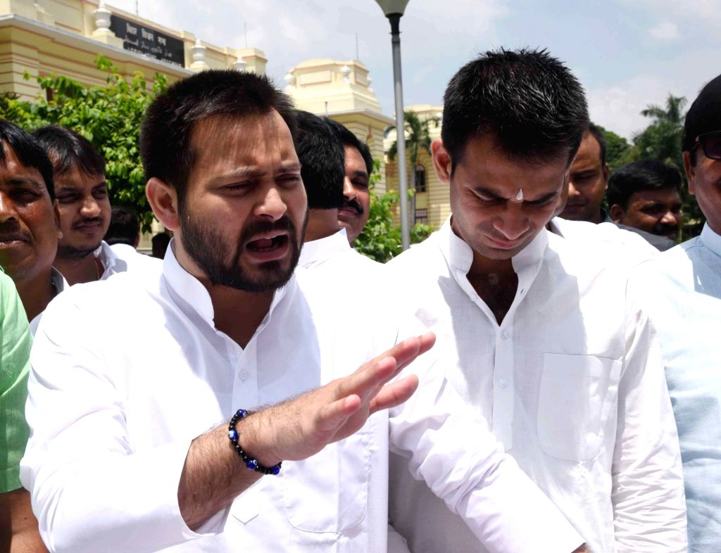 er of the Opposition in Bihar Legislative Assembly Tejashwi Yadav talks to the press during the monsoon session in Patna on Aug 21, 2017. Also seen RJD leader Tej Pratap Yadav. - Tej Pratap Yadav