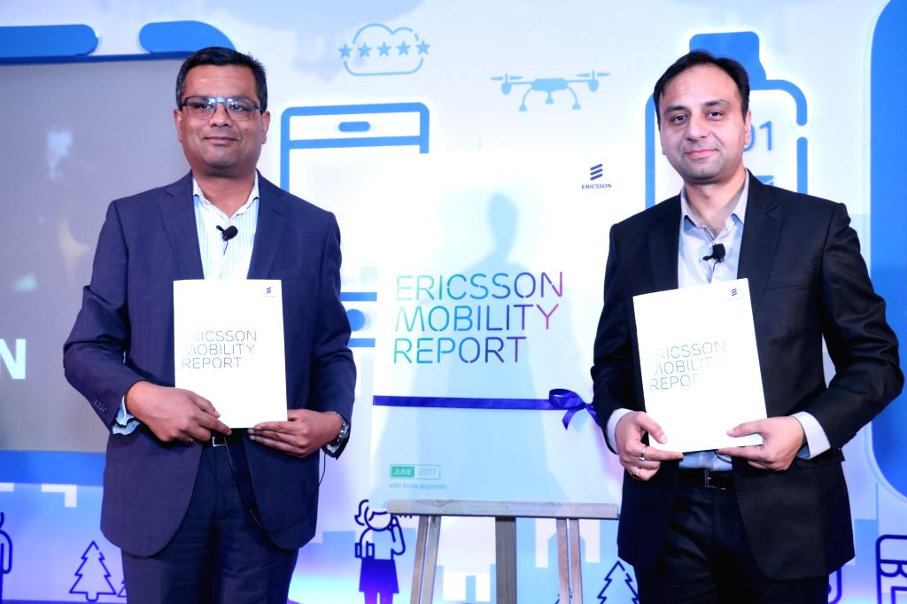"Ericsson India Head of Network Products Nitin Bansal (L) and Head of Network Product Solutions Amit Bhardwaj (R) release ""Ericsson Mobility Report 2017"" in New Delhi, on June 14, ..."