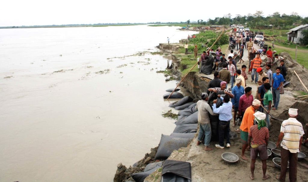 Erosion hit embankments of mighty Brahmaputra river of Assam at Nimatighat in Jorhat on MAY 05 ,2013.In recent years mighty river Brahmaputra has eroded major portion of the land in assam making ...