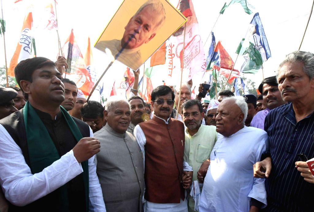 ers of Grand Alliance in Bihar - Congress state President Madan Mohan Jha, HAM-S chief Jitan Ram Manjhi, Rashtriya Lok Samta Party (RLSP) President Upendra Kushwaha and Vikassheel ...