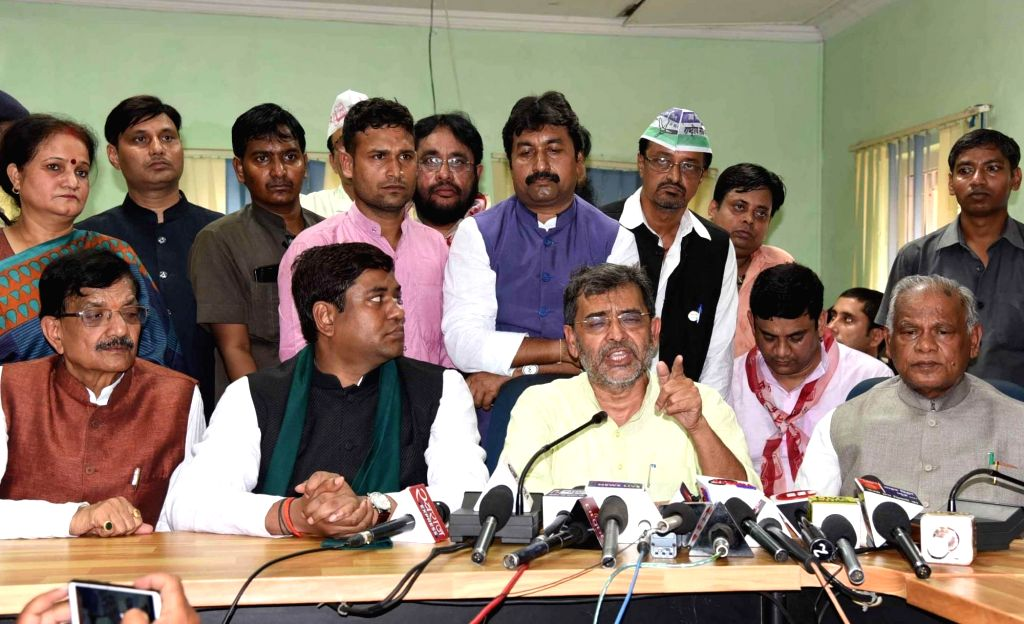 ers of Grand Alliance in Bihar - Rashtriya Lok Samta Party (RLSP) President Upendra Kushwaha accompanied by Congress state President Madan Mohan Jha, HAM-S chief Jitan Ram Manjhi and ...