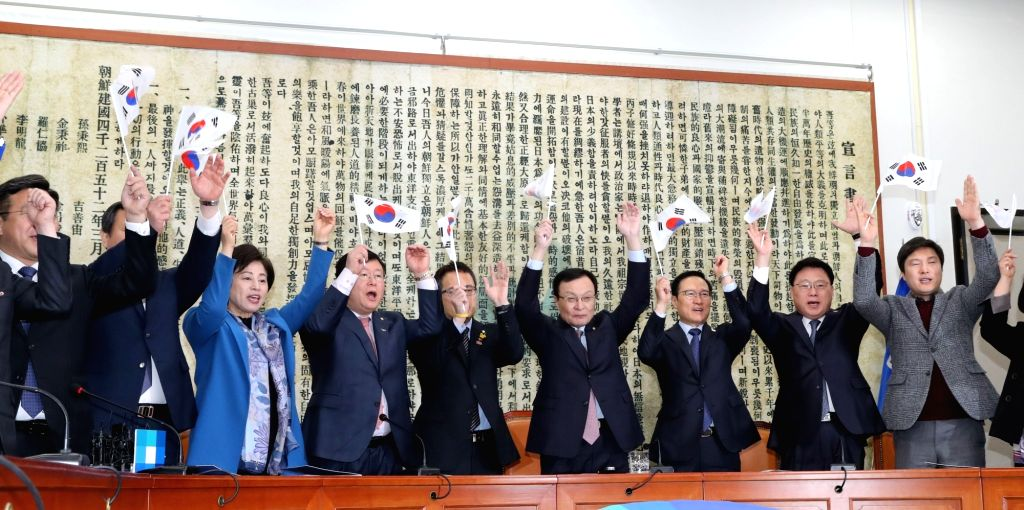 ers of the ruling Democratic Party reenact the March 1 Independence Movement at the National Assembly in Seoul on Feb. 25, 2019, to mark the centennial of the nationwide civil uprising ...