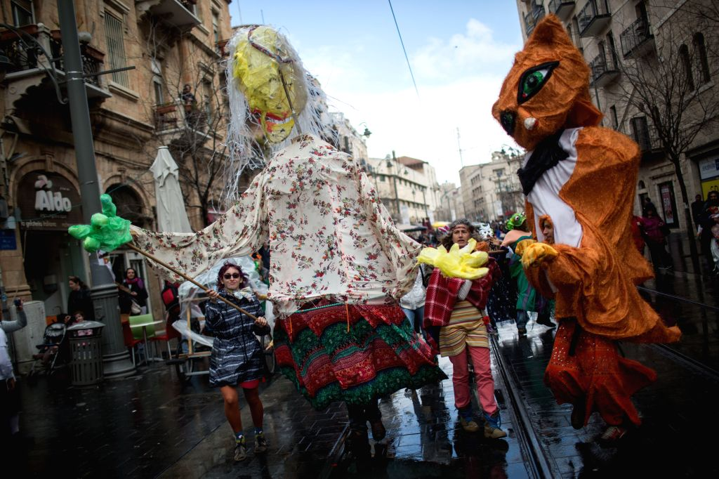 ERUSALEM, March 13, 2017 - People celebrate Purim in central Jerusalem, on March 13, 2017. Purim is a Jewish holiday that commemorates the deliverance of the Jewish people from Haman's plot during ...