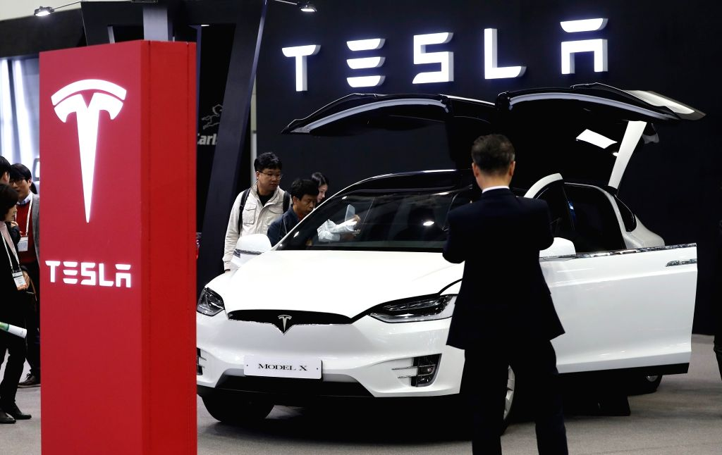 esla Motors Inc., a U.S. electric vehicle manufacturer, unveils a Tesla Model X crossover utility vehicle during the International Future Auto Expo at the exhibition and convention center in ... - X