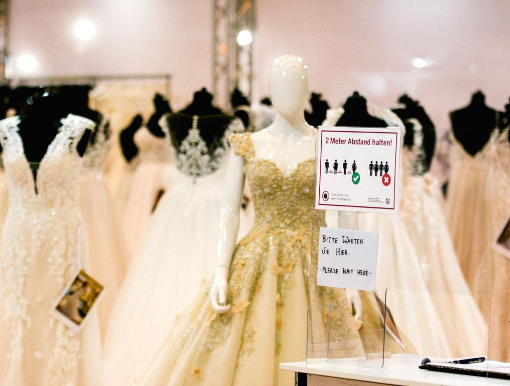 Essen (Germany), July 5, 2020 A sign reminding people to observe social distancing is seen at the European Bridal Week trade fair in Essen, Germany, July 5, 2020. The European Bridal ...