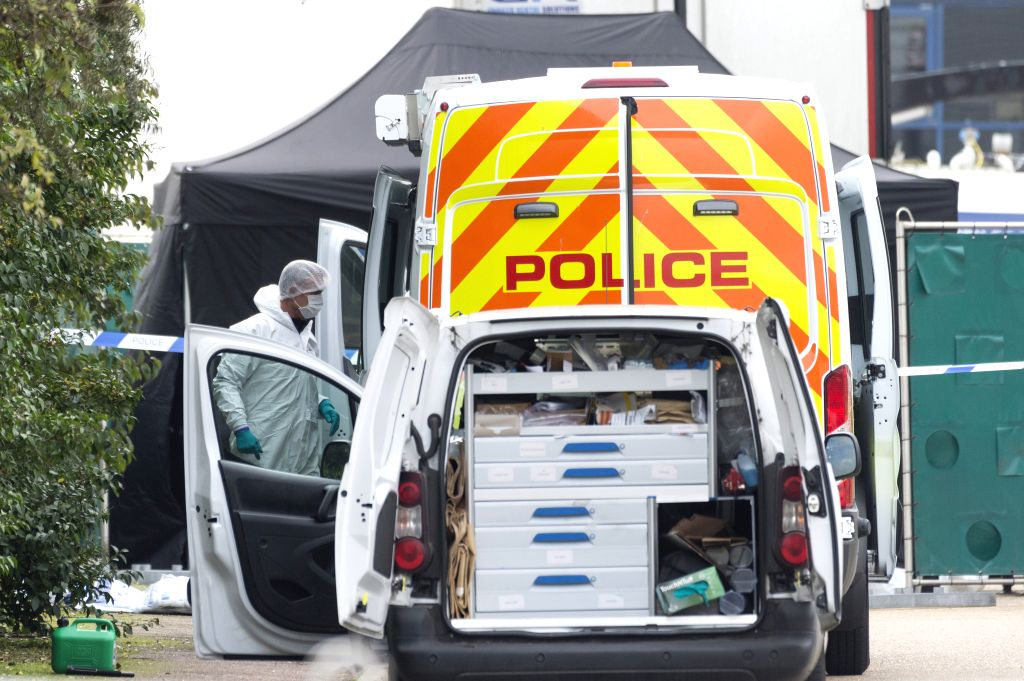 ESSEX (BRITAIN), Oct. 23, 2019 (Xinhua) -- A police forensic officer works at the scene where 39 bodies were found in a shipping container at Waterglade Industrial Park in Essex, Britain, on Oct. 23, 2019. The bodies of 39 people were found Wednesday