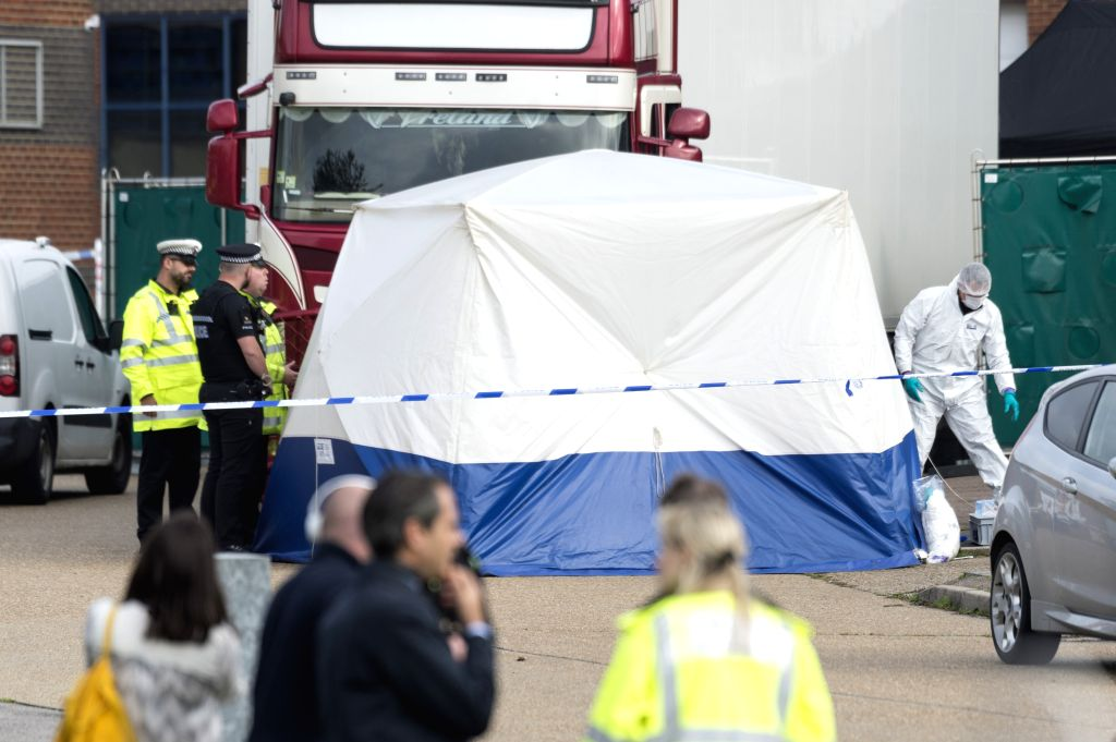 ESSEX (BRITAIN), Oct. 23, 2019 (Xinhua) -- Police officers work at the scene where 39 bodies were found in a shipping container at Waterglade Industrial Park in Essex, Britain, on Oct. 23, 2019. The bodies of 39 people were found Wednesday in a shipp