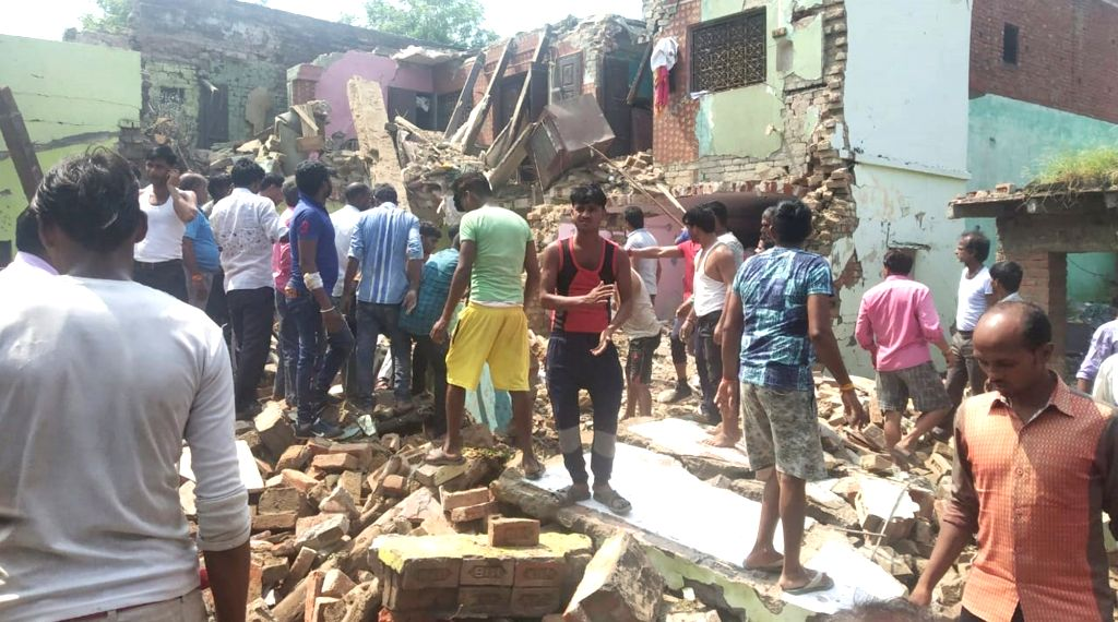 Etah: Locals gather at the cracker factory where six people, including the owner, were killed and several others injured in a blast, in Etah district of Uttar Pradesh on Sep 21, 2019. (Photo: IANS)