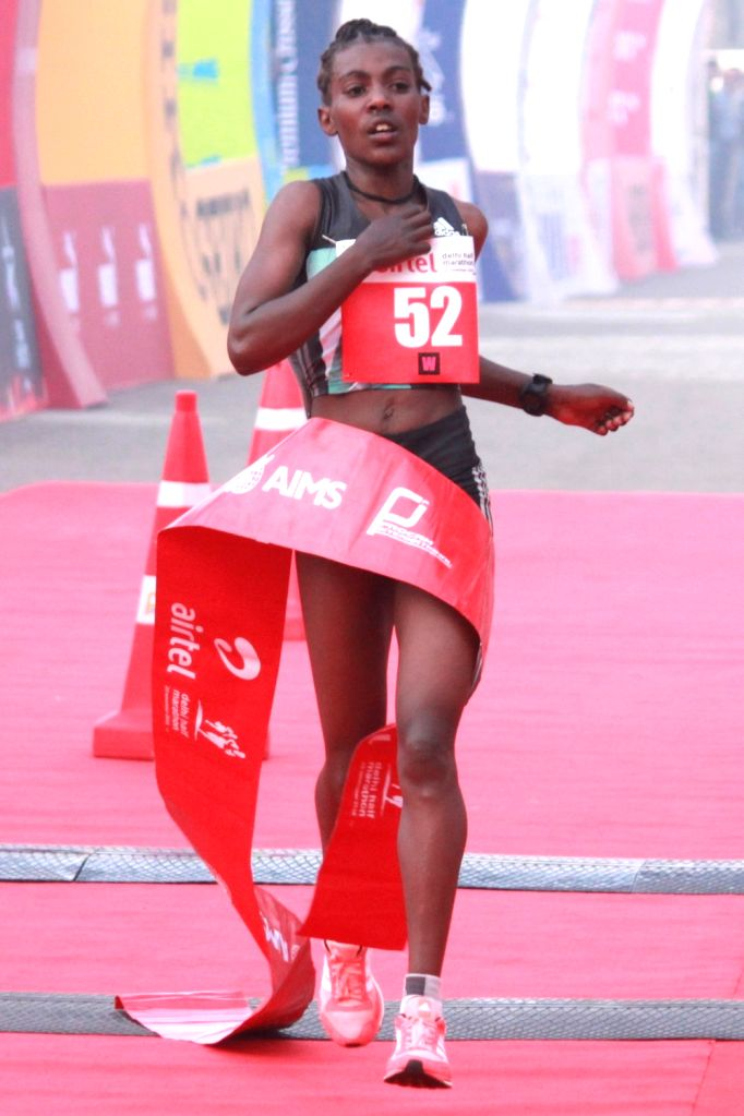 Ethiopia's Worknesh Degefa winner of the women's race in Airtel Delhi Half Marathon 2016 at Jawaharlal Nehru Stadium in New Delhi, on Nov 20, 2016.