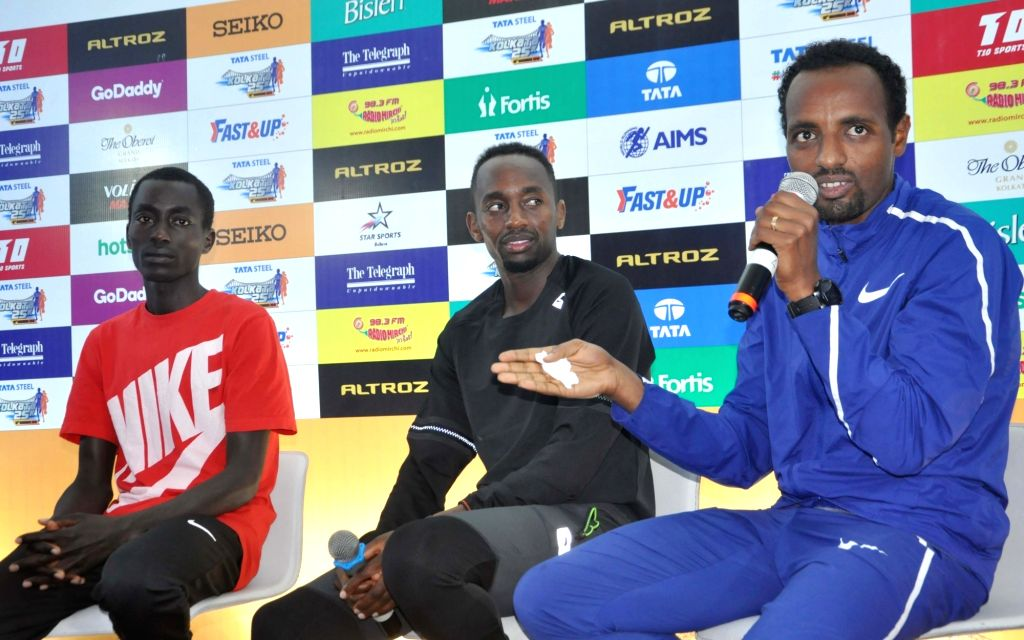 Ethiopian athlete Tariku Bekele accompanied by his Kenyan counterpart Leonard Barsoton and American runner Stanley Kebenei, addresses at a press conference ahead of Tata Steel Kolkata 25k ...