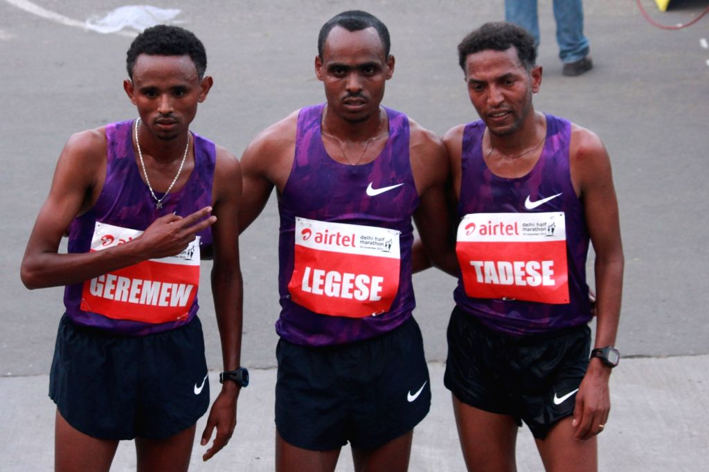 Ethiopian Birhanu Legese, Mosinet Geremew and Eritrea`s Zersenay Tadese after the finish of Elite Men event at the Airtel Delhi Half Marathon, on Nov 29, 2015.
