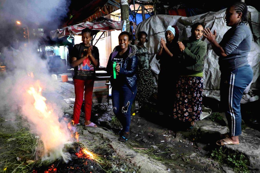 Ethiopian women celebrate around a bonfire on the eve of the Ethiopian New Year in Addis Ababa, capital of Ethiopia, on Sept. 10, 2020. Ethiopians on Friday ...