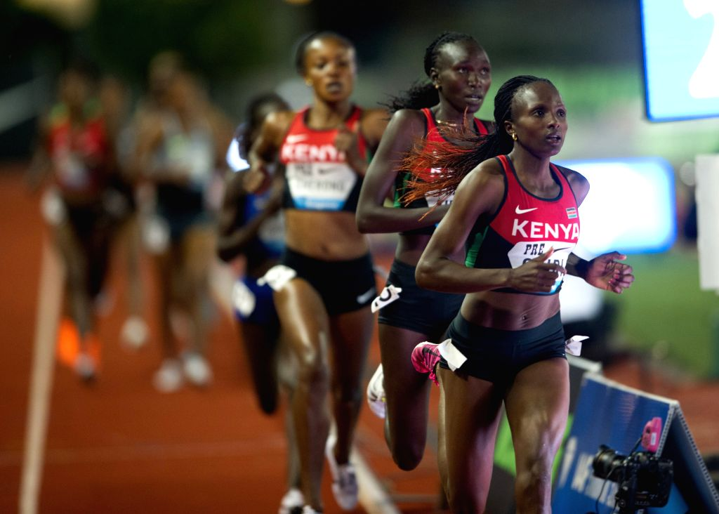 EUGENE, May 28, 2016 - Hellen Onsando Obiri(R) of Kenya competes during the Women's 5000 Metres Final at the 2016 IAAF Diamond League in Eugene, the United States, on May 27, 2016. Hellen Onsando ...
