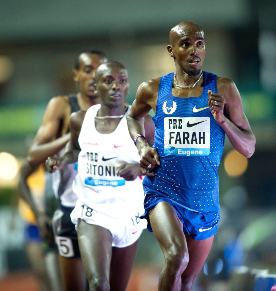 EUGENE, May 28, 2016 - Mo Farah(R) of Great Britain competes during the Men's 10,000 Meters Final at the 2016 IAAF Diamond League in Eugene, the United States, on May 27, 2016. Mo Farah claimed the ...