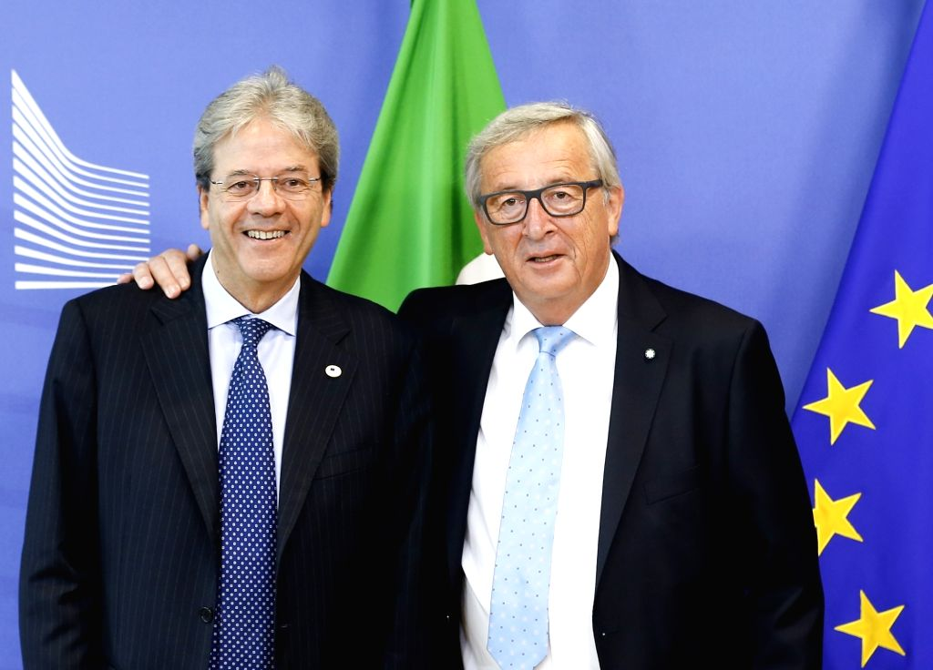 European Commission President Jean-Claude Juncker (R) meets with Italian Prime Minister Paolo Gentiloni prior to a meeting at EU headquarters in Brussels, Belgium, June 22, 2017. - Paolo Gentiloni