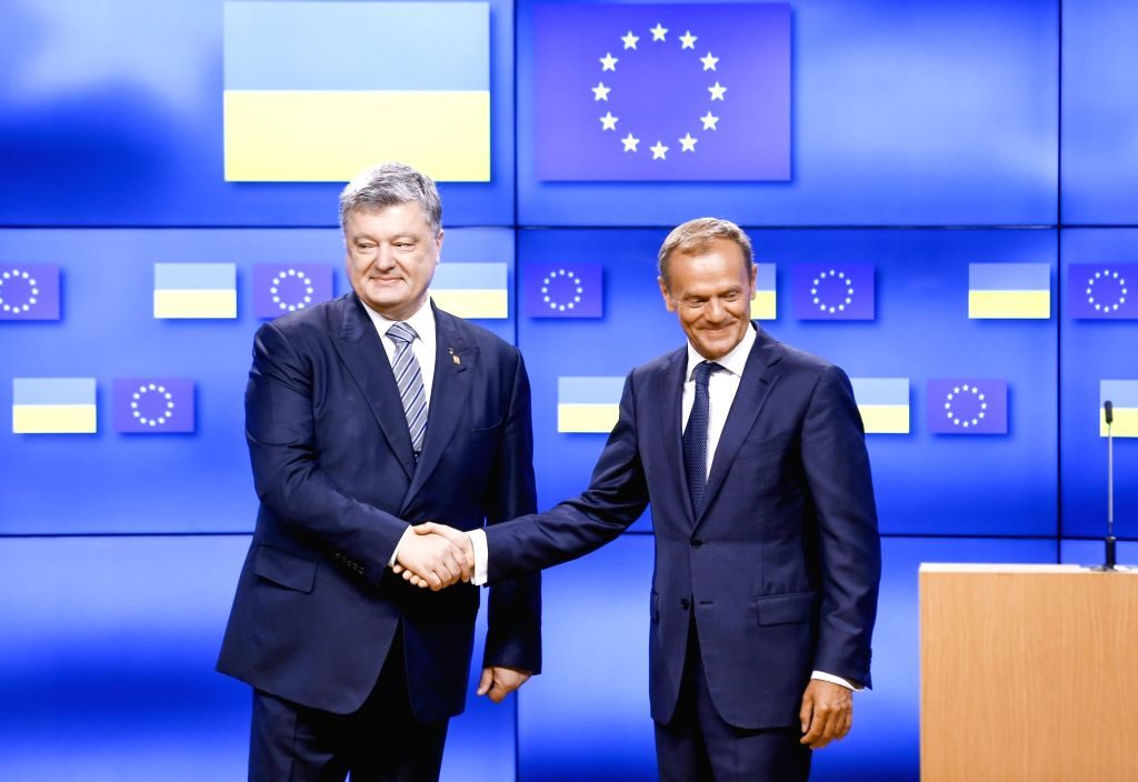European Council President Donald Tusk (L) shakes hands with Ukrainian President Petro Poroshenko prior to an EU summit meeting in Brussels, Belgium, June 22, 2017.