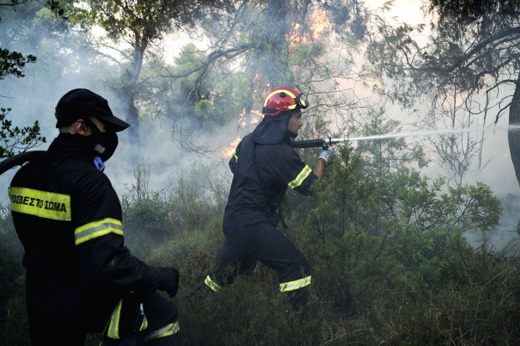 EVIA ISLAND (GREECE), Aug. 13, 2019 Firefighters battle a wildfire near Makrymalli village on Evia island, Greece, on Aug. 13, 2019. Greek firefighters battled the largest wildfires of ...
