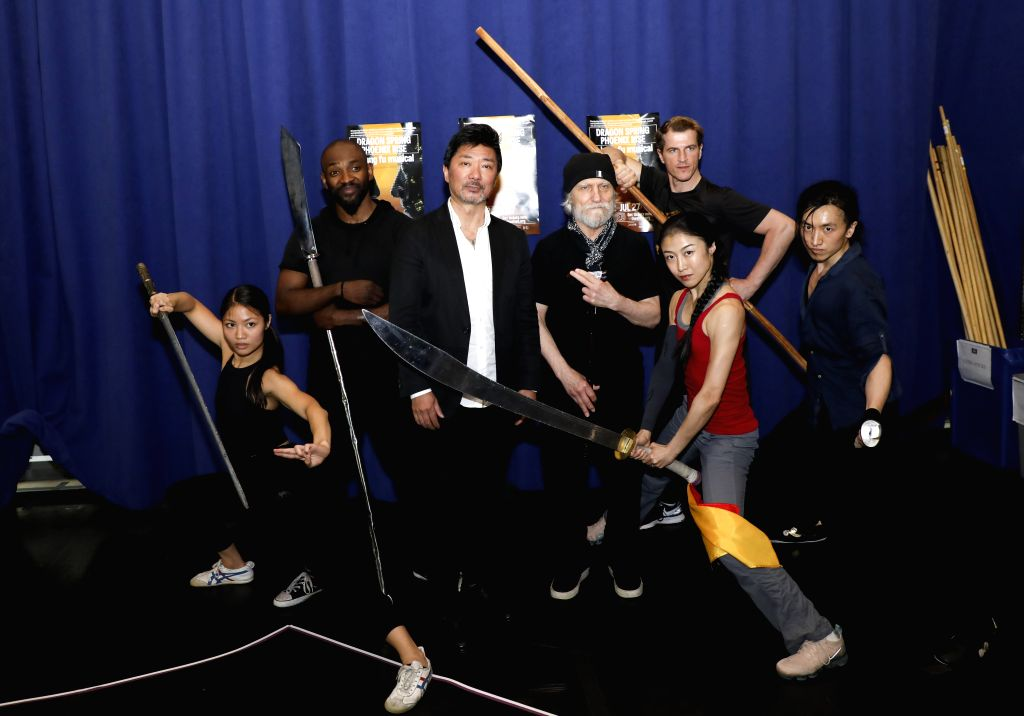 EW YORK, June 7, 2019 - Director Chen Shi-Zheng and some of the cast members pose for a photo during a media preview of the musical Dragon Spring Phoenix Rise, in New York, the United States, June 6, ...