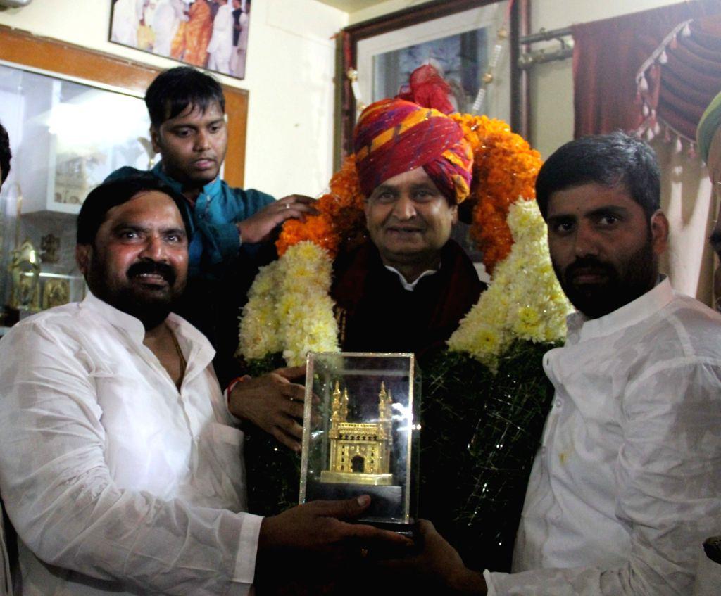 Ex Congress MP Anjan Kumar Yadav felicitates Congress general secretary Ashok Gehlot in Hyderabad on Sept 17, 2017. - Anjan Kumar Yadav