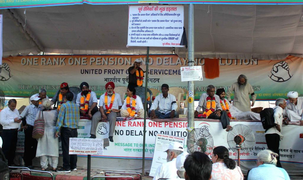 Ex-servicemen stage a demonstration to press for One Rank One Pension -OROP- in New Delhi, on Aug 17, 2015.
