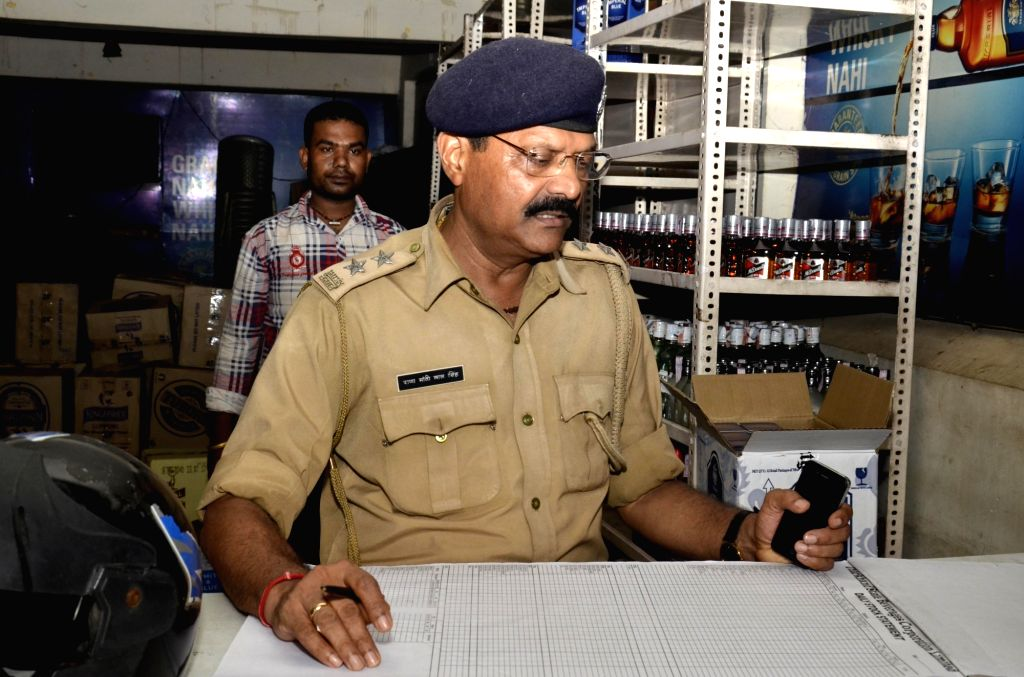 Excise and custom officials checks the stock of a newly opened liquor shop in Ranchi on Aug 1, 2017. Jharkhand government started selling liquor from Tuesday from the 210 shops it has opened ...