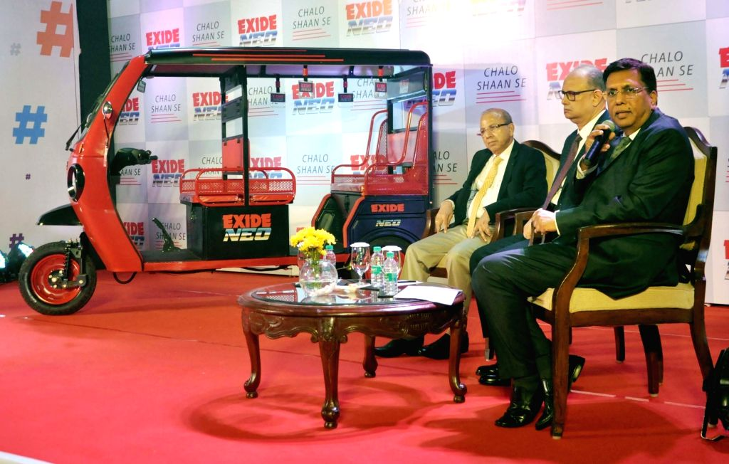 """Exide Industries Ltd MD and CEO Gautam Chatterjee, Deputy Managing Director Subir Chakroborty and Director Automotive Arun Mittal during the lunch of new electric vehicle """"Exide ... - Gautam Chatterjee"""