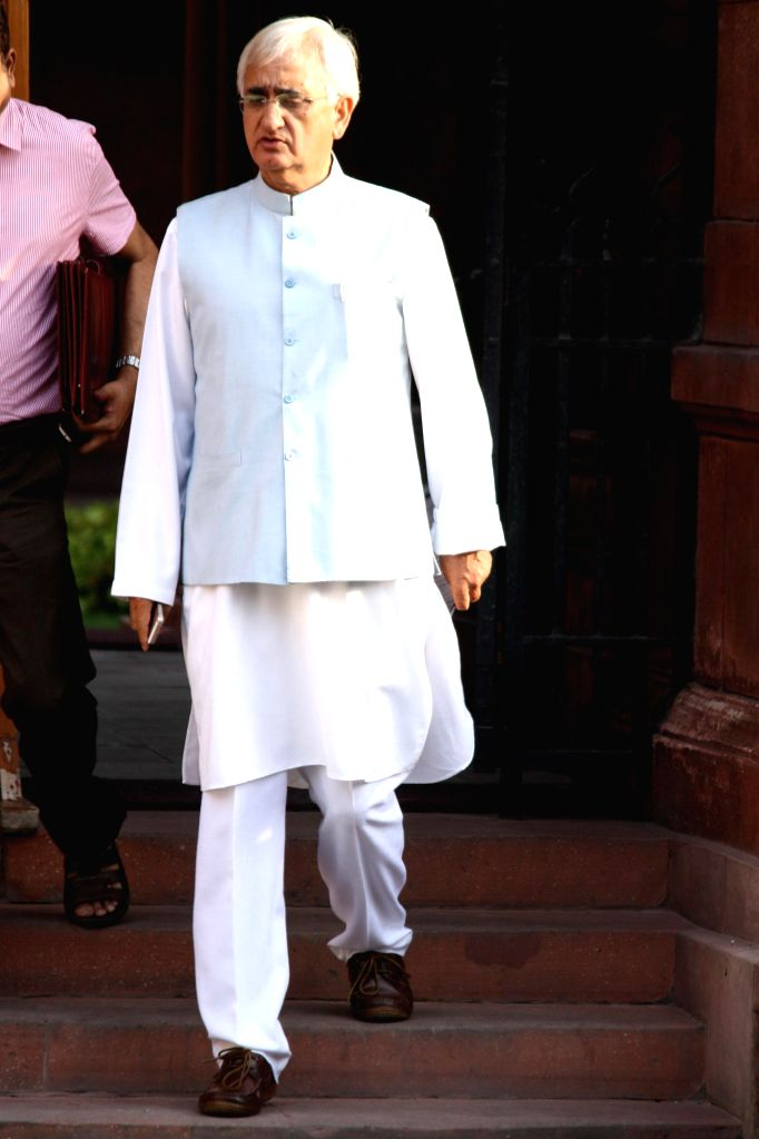 External Affairs Minister Salman Khurshid comes out after the last cabinet meeting of UPA-II government in New Delhi on May 13, 2014. - Salman Khurshid
