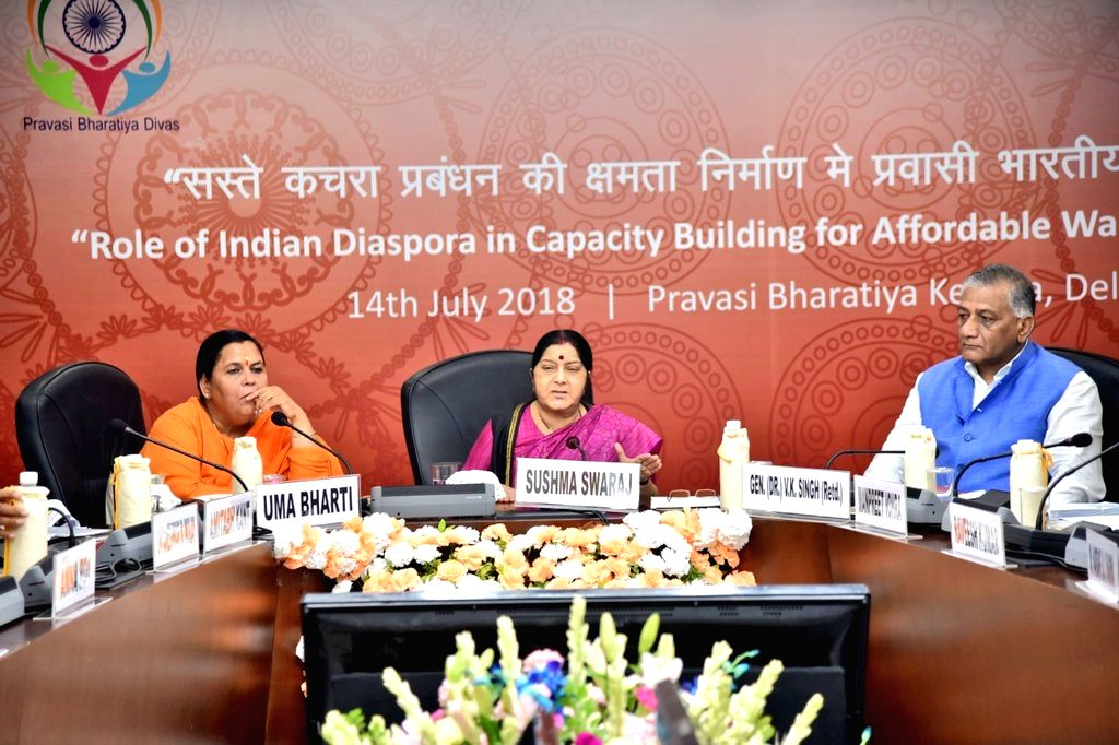 "External Affairs Minister Sushma Swaraj addresses during Pravasi Bharatiya Divas Conference on ""Role of Indian diaspora in capacity building in affordable waste management"" along ... - Sushma Swaraj and K. Singh"