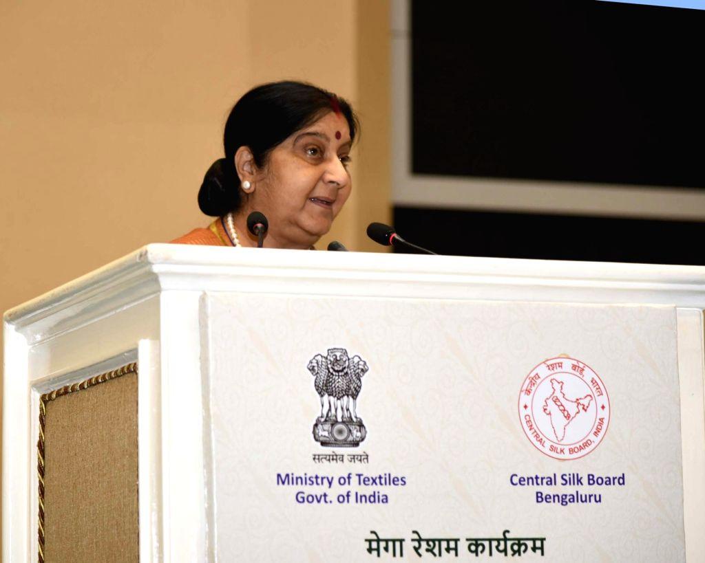 External Affairs Minister Sushma Swaraj addresses at a Mega Silk event - Surging Silk, Accomplishment and way forward, in New Delhi on Feb 9, 2019. - Sushma Swaraj