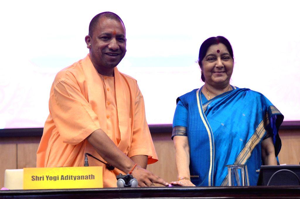 External Affairs Minister Sushma Swaraj and Uttar Pradesh Chief Minister Yogi Adityanath at the launch of the website for 15th Pravasi Bhartiya Divas, in New Delhi on Sept 15, 2018. - Sushma Swaraj