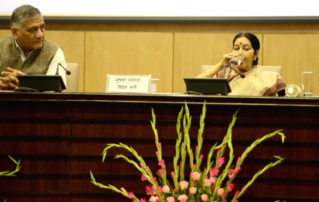 External Affairs Minister Sushma Swaraj during a formal session of passport Seva Devas in New Delhi on June 24, 2016. Also seen Union Minister of State for External Affairs General (Retd.) ... - Sushma Swaraj and K. Singh