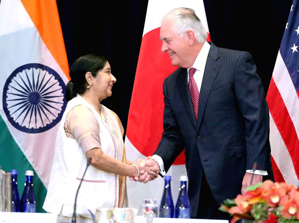 External Affairs Minister Sushma Swaraj is greeted by United States Secretary of State Rex Tillerson at the start of the trilateral meeting between India, the US and Japan in New York on Monday, ... - Sushma Swaraj