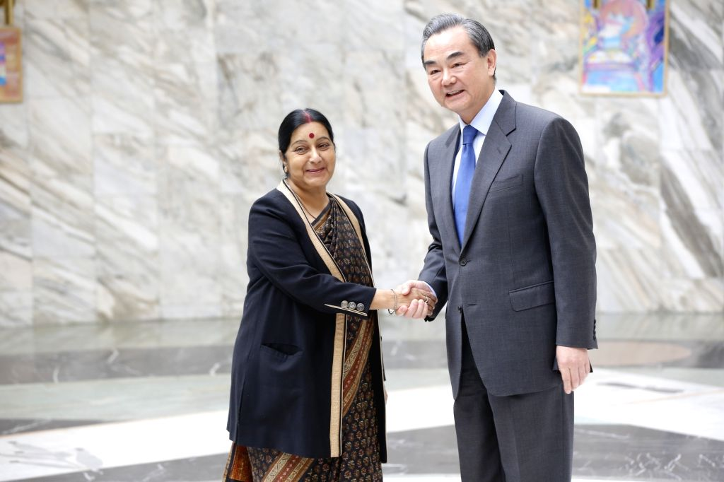 External Affairs Minister Sushma Swaraj meets Wang Yi, Foreign Minister of China in Moscow on April 18, 2016. - Sushma Swaraj
