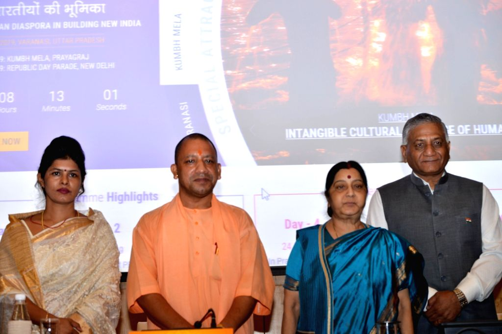 External Affairs Minister Sushma Swaraj, MoS External Affairs V.K. Singh and Uttar Pradesh Chief Minister Yogi Adityanath at the launch of the website for 15th Pravasi Bhartiya Divas, in ... - Sushma Swaraj and K. Singh