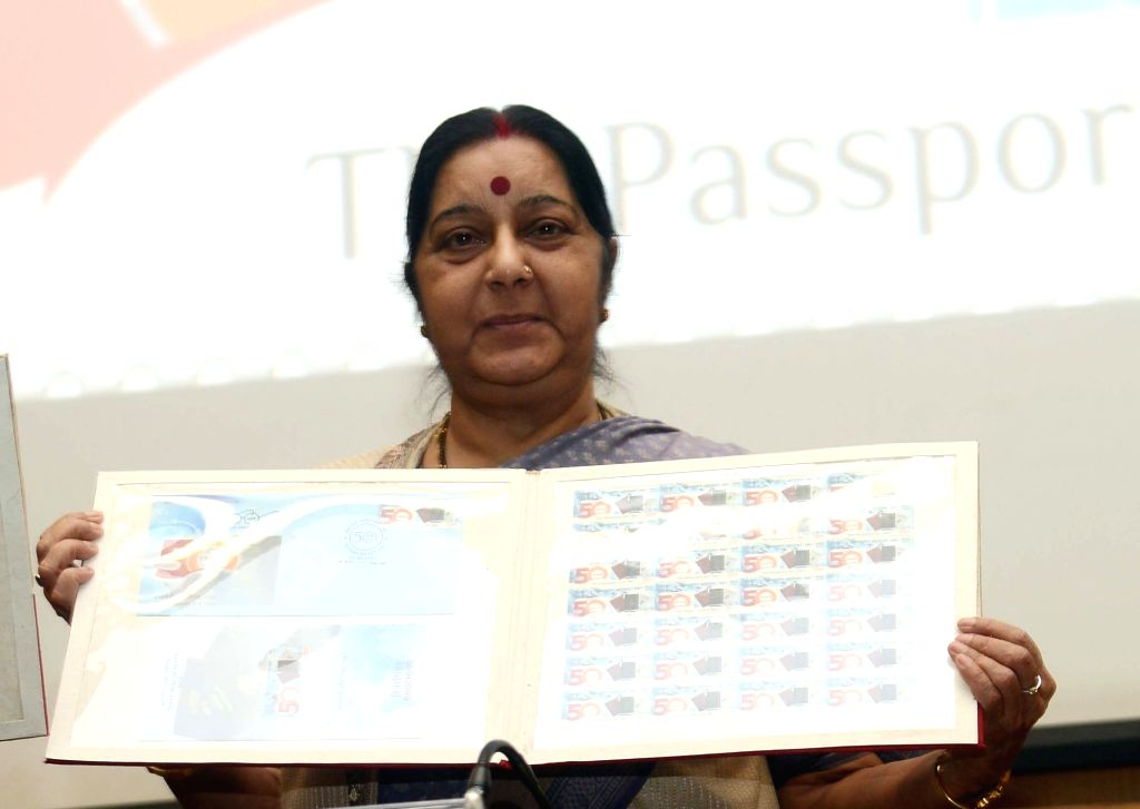 External Affairs Minister Sushma Swaraj unveil a stamp on Passport Seva Divas in New Delhi, on June 23, 2017. - Sushma Swaraj