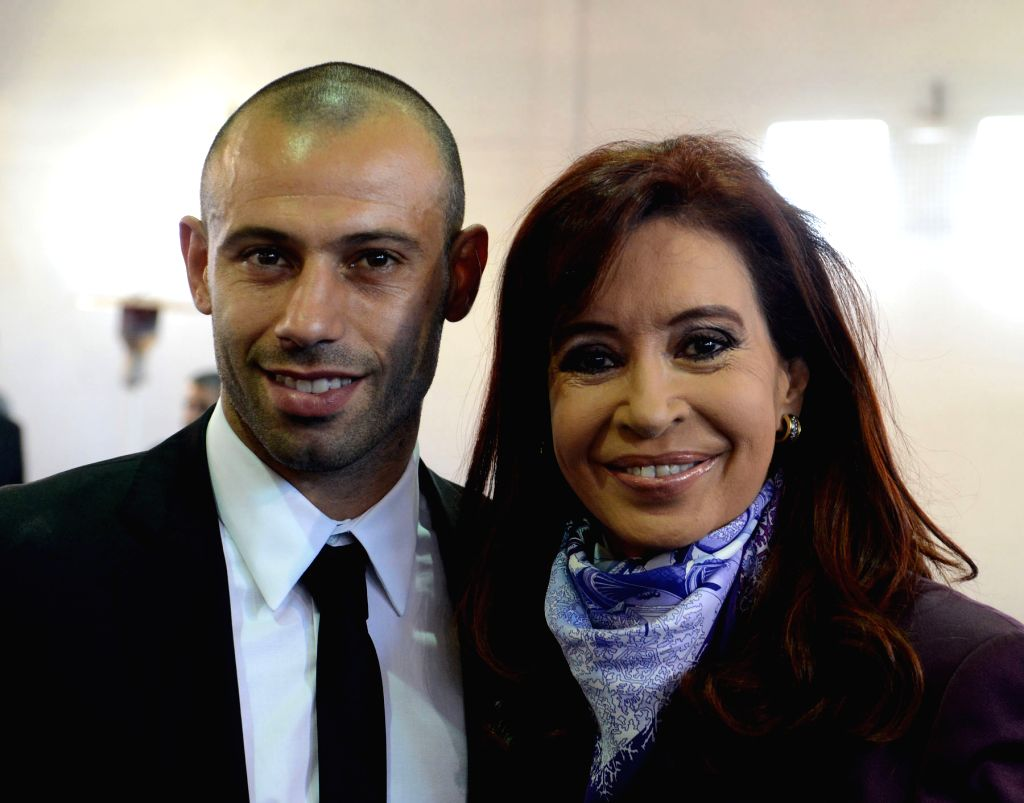 Argentine President Cristina Fernandez (R) poses with Javier Mascherano (L) of Argentina's national soccer team, at the Argentine Soccer Association (AFA, for its ...