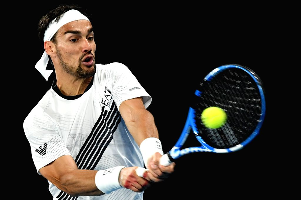 Fabio Fognini of Italy hits the ball during the men's singles third round match against Guido Pella of Argentina at the 2020 Australian Open tennis tournament in ...