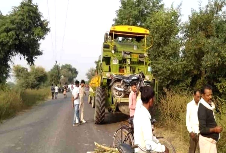 Face-to-face collision of harvester machine and motorcycle.