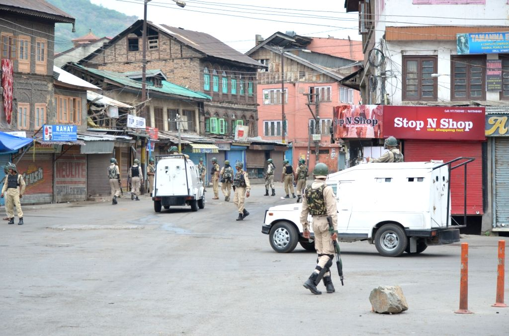 Faisal Ahmad walked five kilometres from his home in Rainawari in downtown Srinagar to a makeshift telephone booth in the upscale Jawahar Nagar to make a voice call to his brother who works in Qatar. (Photo: IANS)