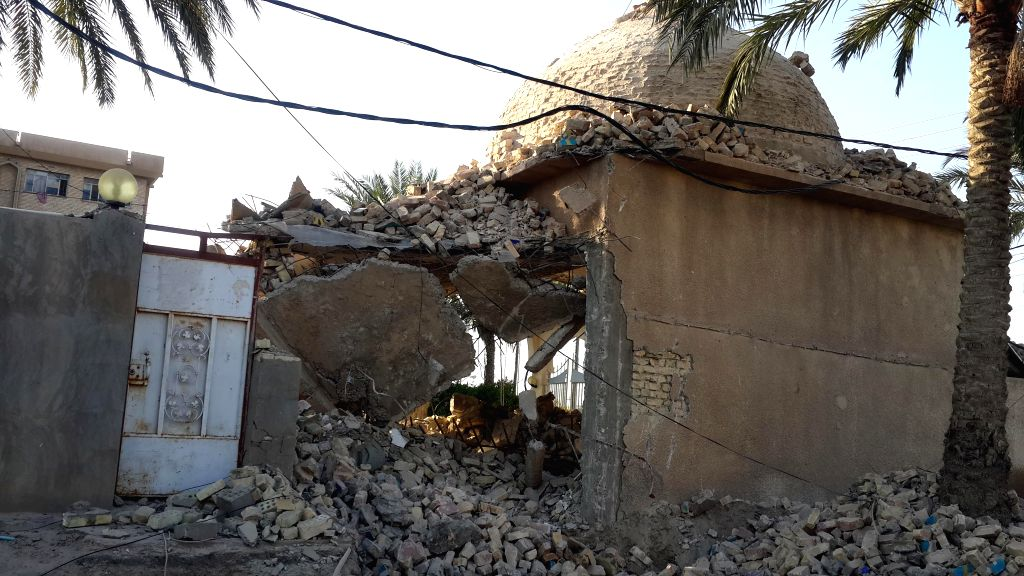 Fallujah (Iraq): Photo taken on Dec. 7, 2014 shows a damaged mosque after Iraqi Air Force's bombing in Islamic State militant seized city of Fallujah, 50 km west of Baghdad, Iraq. At least three ...