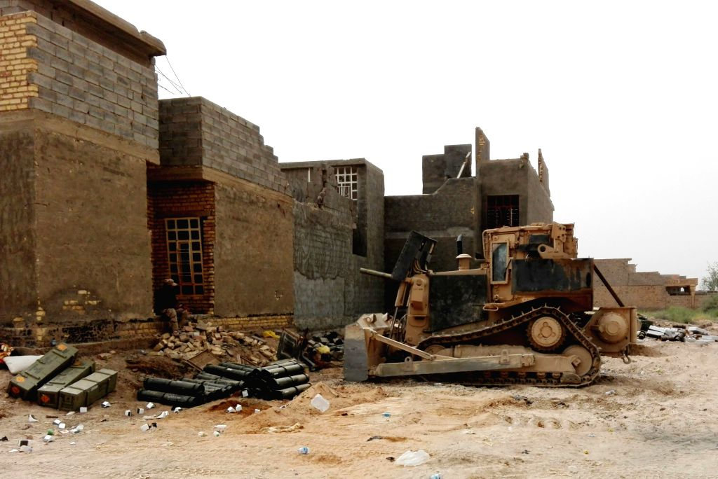 FALLUJAH, June 18, 2016 - Photo taken on June 17, 2016 shows damaged buildings in Fallujah, Anbar province, Iraq. Iraqi Prime Minister Haider al-Abadi announced Friday substantial victory against the ... - Haider