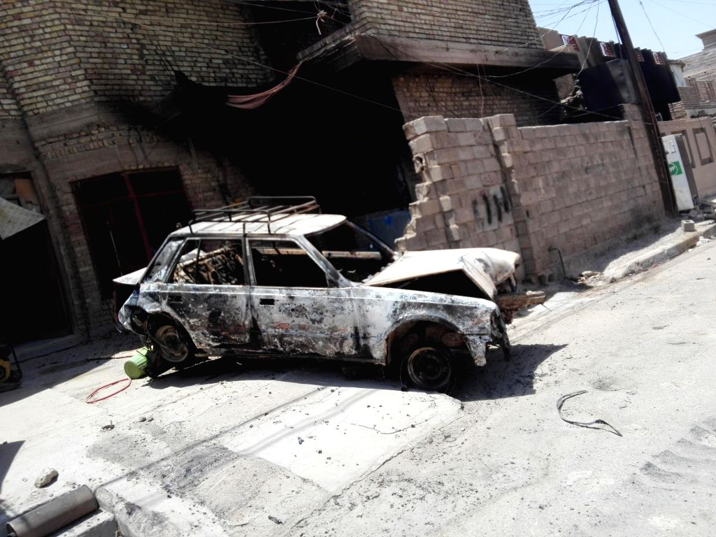 FALLUJAH, June 27, 2016 - A destroyed vehicle is seen in Fallujah city of western Iraq's Anbar province, on June 26, 2016. A senior Iraqi commander on Sunday declared full liberation of the city of ...