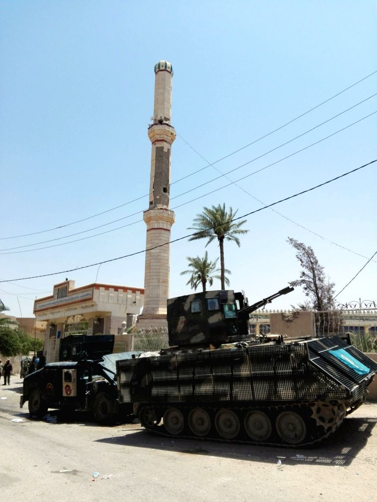 FALLUJAH, June 27, 2016 - Armoured vehicles of Iraqi army are seen in Fallujah city of western Iraq's Anbar province, on June 26, 2016. A senior Iraqi commander on Sunday declared full liberation of ...