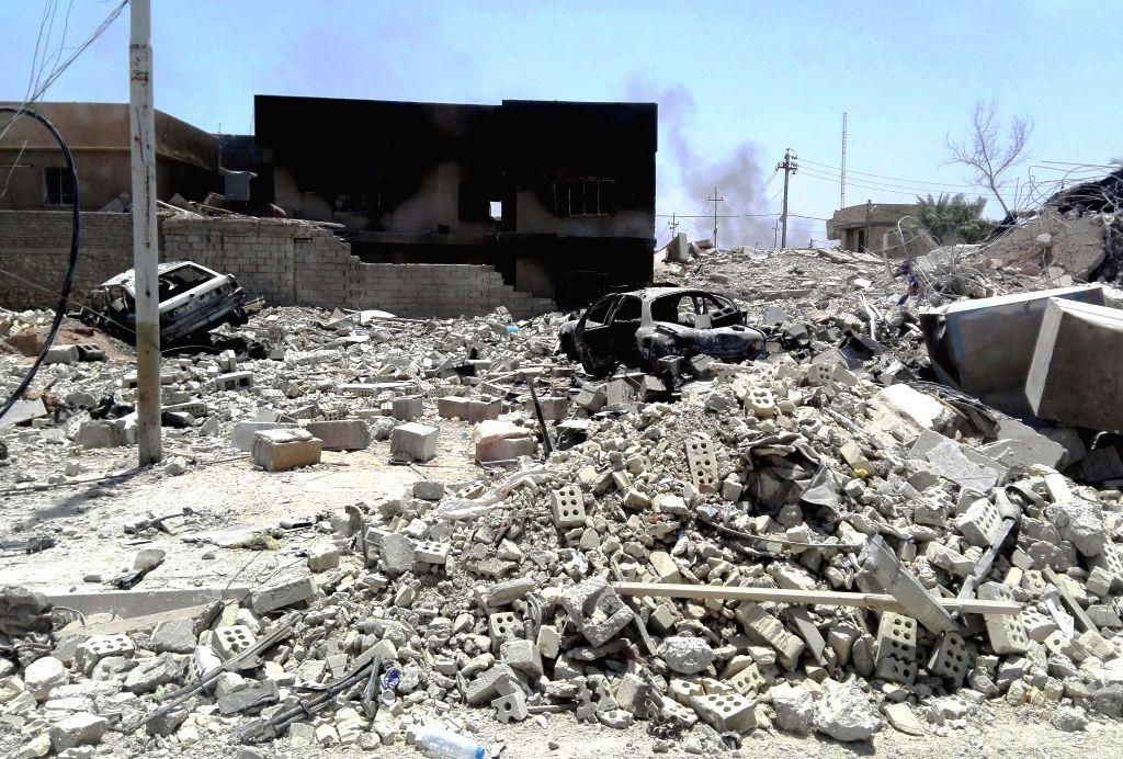 FALLUJAH, June 27, 2016 - Rubbles are seen in Fallujah city of western Iraq's Anbar province, on June 26, 2016. A senior Iraqi commander on Sunday declared full liberation of the city of Fallujah ...
