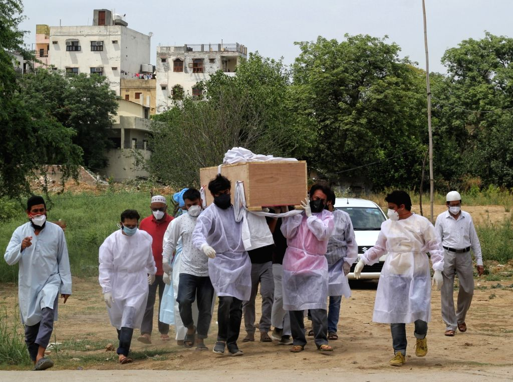 Family members carry the mortal remains of the covid-affected victim for burial during the second wave of Covid-19 at Delhi gate graveyard in New Delhi on Thursday 13 May, 2021.