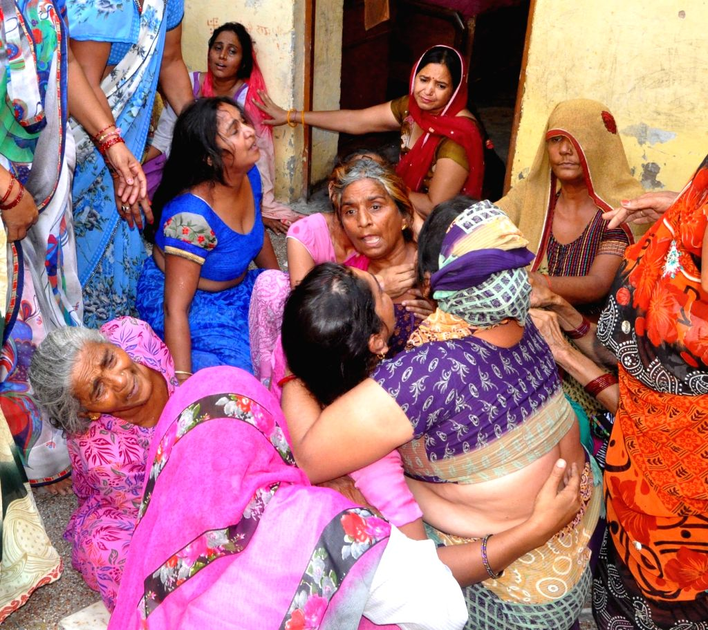 Family members mourn the death of the persons who were killed in a clash over parking issue in Palwali village of Faridabad, Haryana on Sept 18, 2017.